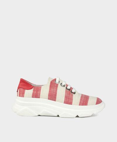 Zapatillas deportivas con suela gruesa en tejido marinero rojo y crudo.